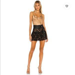 MAJORELLE Skirts - Amara Mini Skirt in Black from majorelle